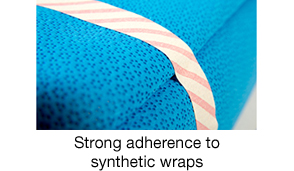 Strong adherence to synthetic wraps
