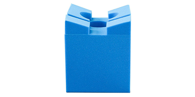 Disposable Richards Slotted Head Rest is a foam head positioner for spinal procedures.