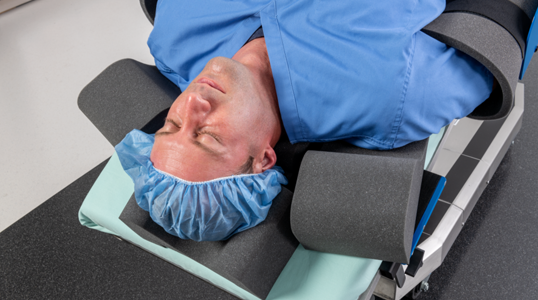 Trendelenburg patient restraint for surgical tables